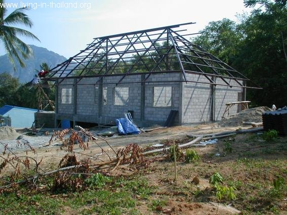 Walls done, roof almost. New roofs are now made from steel, less problems with termites.